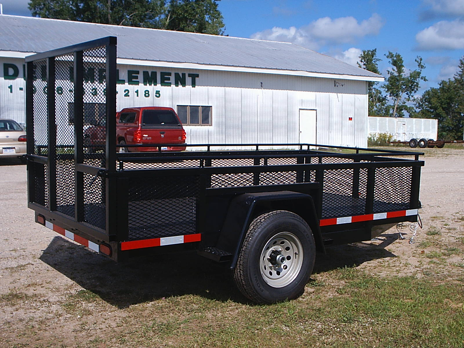 6' x 12' 18 inch mesh sides with 6,000 lb axles with full flip down ramp